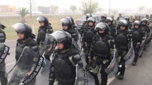 Police in riot gear line up at border to greet migrant caravan as US vows: 'We stand ready'